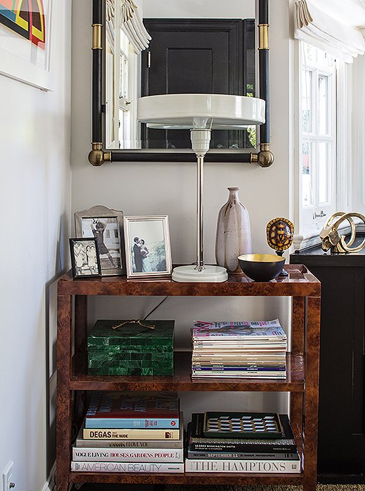 A burlwood tea cart filled with books and topped with a metal lamp anchors one corner of Marlien Rentmeester's Los Angeles home office. Photo by Lesley Unruh.