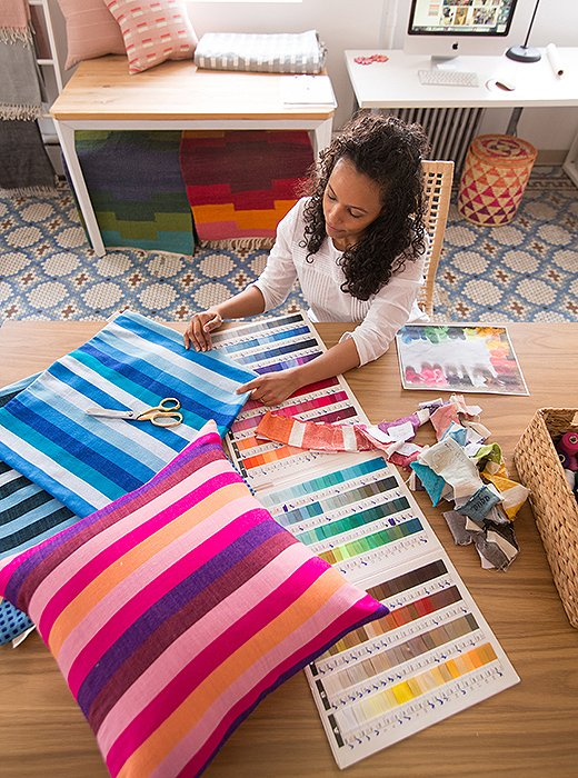 Bolé Road founder Hana Getachew works on textile designs in her Brooklyn studio. Photo courtesy of Bolé Road.