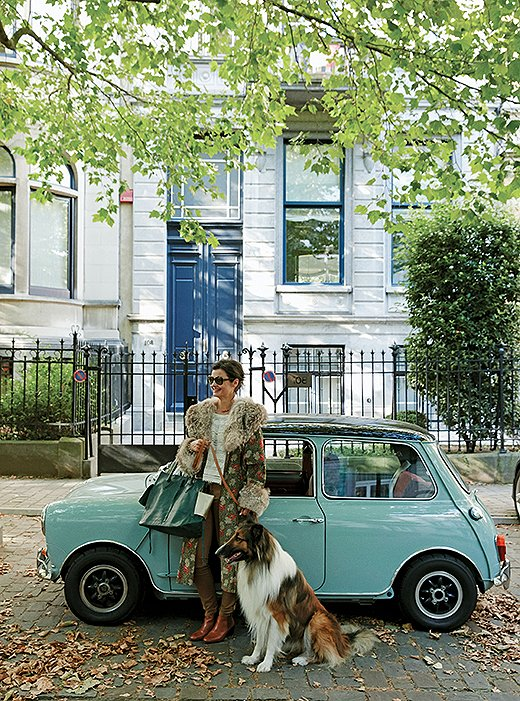 Interior designer Anne-Marie Midy with her pale-blue Mini Cooper and the family collie.