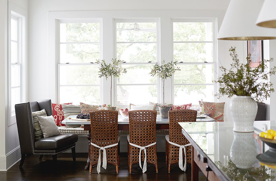 """Dinners at the lake house are almost always casual, according to Barbara. """"But we have had Thanksgiving dinner here, and we just squeeze everybody—which is, I don't know, 14 people—in.Those big chairs at the end of the table are huge, so we put an adult and a grandkid in each of those to make it work."""" For those rare formal occasions, the designer takes her tabletop game seriously: """"I like to decorate. I like great china and great decor and flowers and everything at the table."""""""