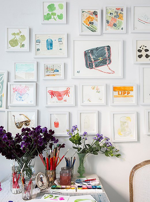 A collection of ladylike watercolors feels fresh and new in matching white frames. Photo by Lesley Unruh.