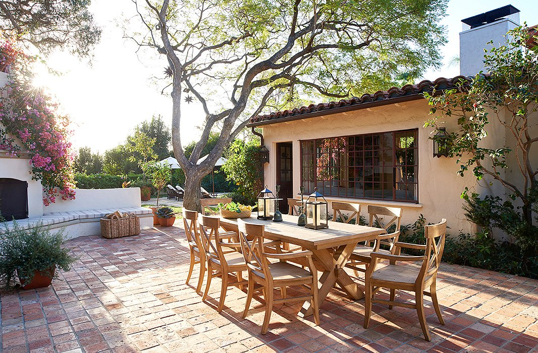 Teak furniture serves as the focal point of the outdoor space  where many  of the. The Polished Bohemia of Hallie Meyers Shyer s  Home Again