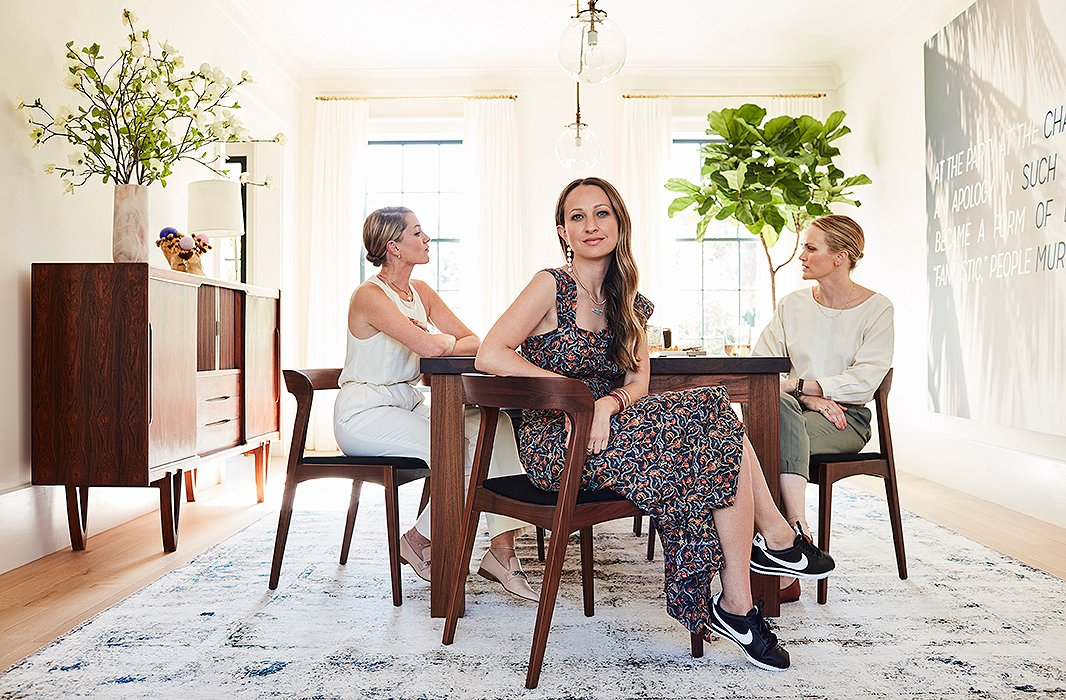 """Not only are Emily and Louisa brilliant designers, but they're such good friends,"" says Jennifer, sitting here in her new dining room. ""In the future, you will see me, Emily, Louisa, and many other people at this table having dinner, drinking, and hanging out for hours and hours."""