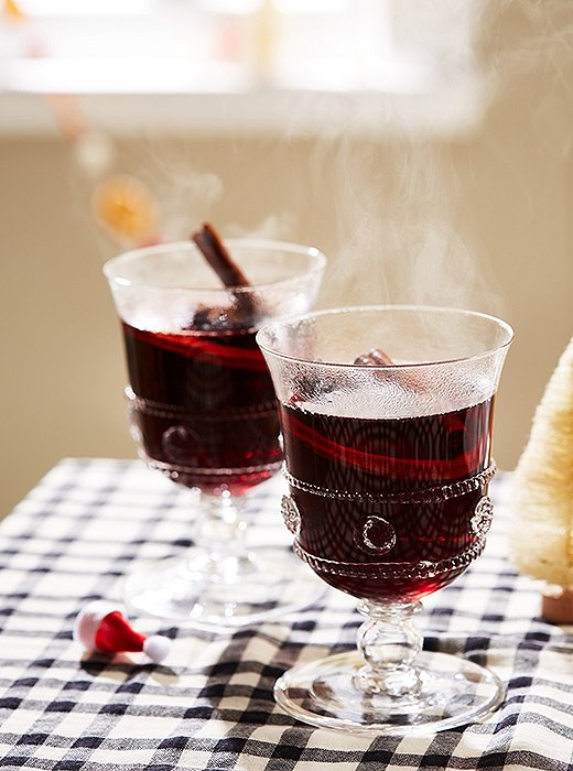 Offering a steaming cup of mulled wine is the perfect way to greet guests.
