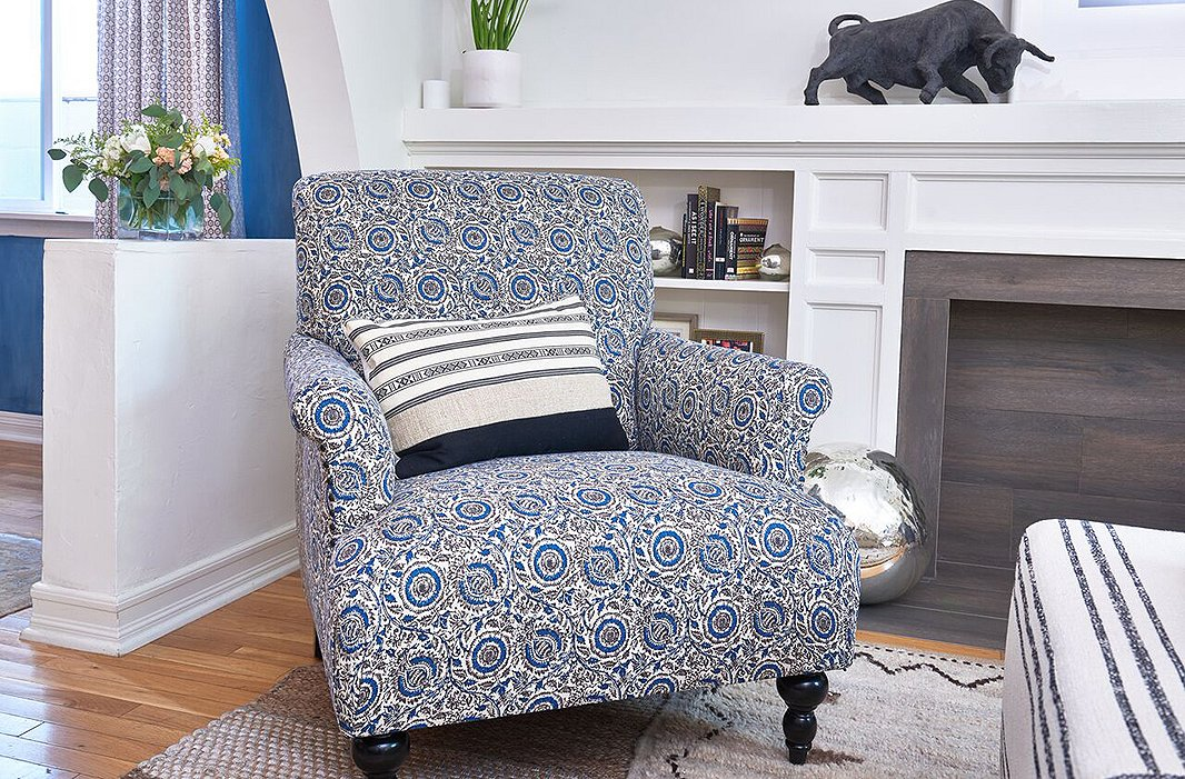 Covered in an intricate indigo floral, the handcrafted Grayson Club Chair is a lively update to a classic English design.