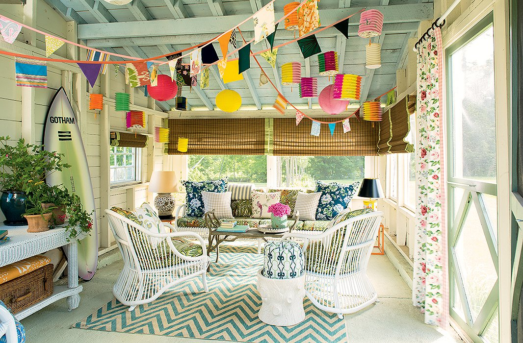 A pop of chevron anchors a sunny porch, accented with rose prints and gingham.
