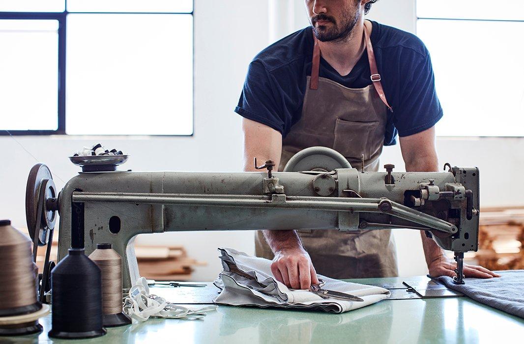 Craftsmen use a quilting machine to create Alden's distinctive channel detailing.