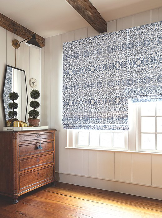 Roman shades in Kaleidoscope add a gorgeously graphic touch to a rustic farmhouse space.