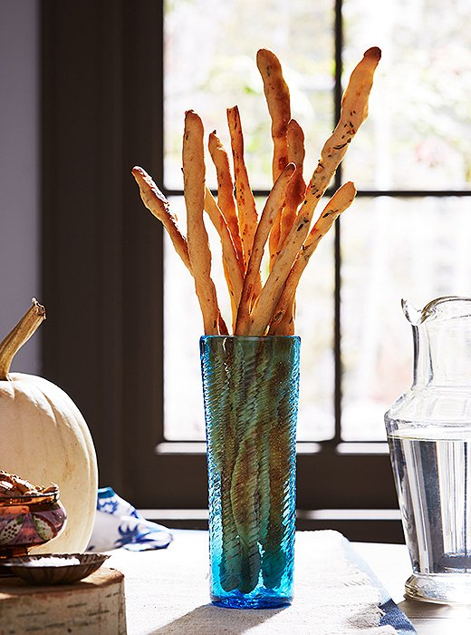 Light yet flavorful, rosemary Parmesan breadsticks make a perfect cocktail-hour nosh.
