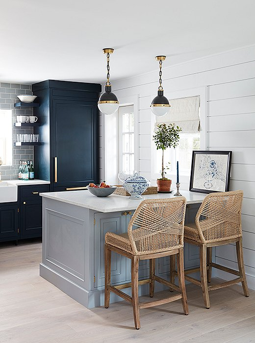 Kitchen stools offer a mod touch with a nautical twist, pairing perfectly with the clean look of the kitchen, which was designed by Will.
