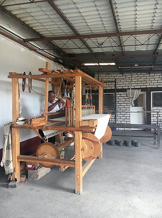 Artisans use wooden looms to weave Paradise People's beach blankets. Photo courtesy of Paradise People.
