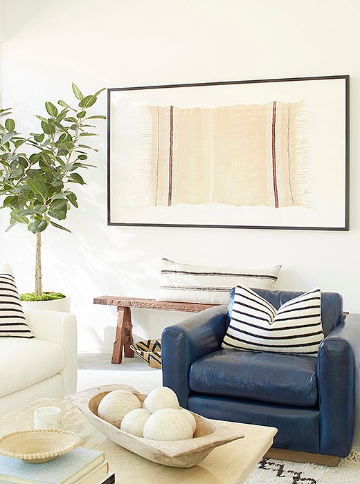 A striped Berber throw was framed as art and centered above an antique Shandong bench.