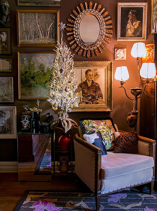 "A silver tree—trimmed with vintage ornaments, of course—brings a festive feel to a cozy reading nook. ""Vintage ornaments add that nostalgic, sentimental vibe to a home, and people often have a very warm and fuzzy response to them,"" Bob writes."