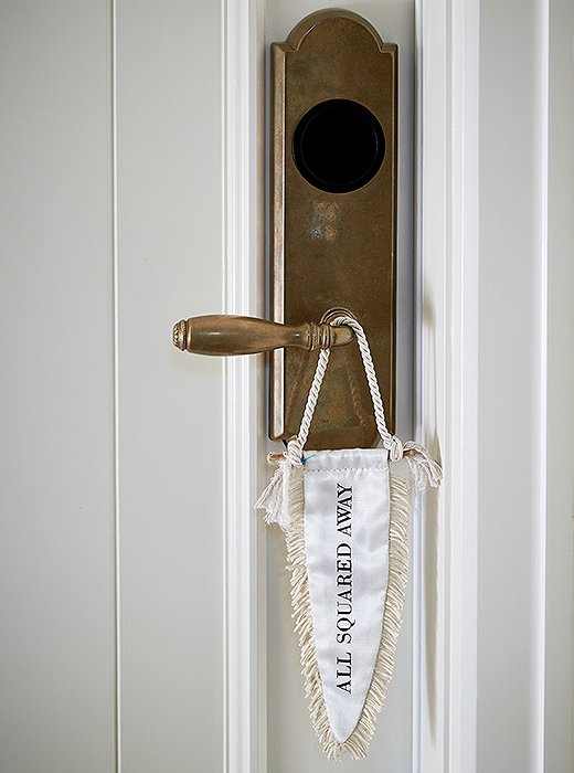 "The owners worked with Cory Schifler of Urchin Workshop to design cheeky accessories for the space, including these doorknob flags—a creative take on ""Please make up this room."""