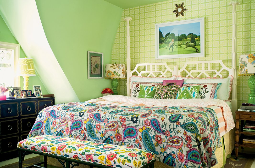 United by green and varied in scale, this bedroom's seven prints appear perfect together.