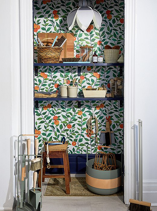 A citrus-print wallpaper gives a utility closet some welcome sunshine.