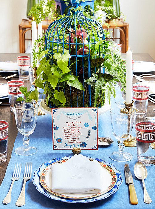 When she's not creating custom decorative pastry sheets, Stephanie is running her other business, the Victory Club—a supper club catering to creative groups. Her hand-painted menus are a signature; she made this one to coordinate with a mix of vintage tableware found on One Kings Lane. An arrangement of tropical plants inside a blue-painted birdcage makes for a fabulous (and long-lasting) centerpiece.