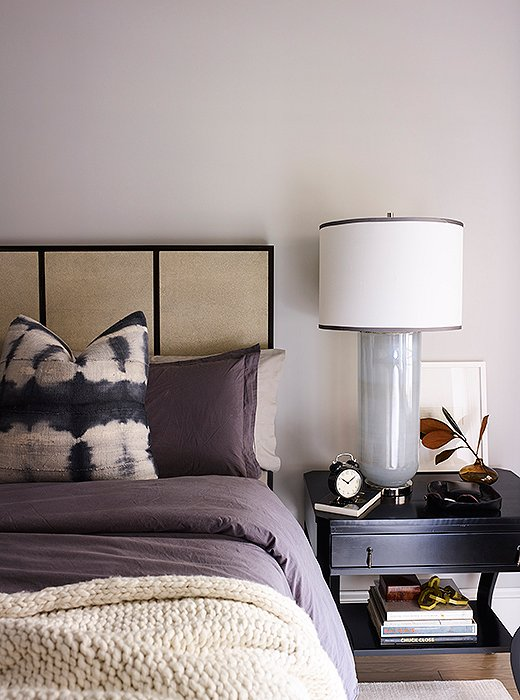 A shagreen-paneled bed by Mr. and Mrs. Howard takes center stage in the bedroom. Oversize nightstands by Noir and Jamie Young lamps match its king size.
