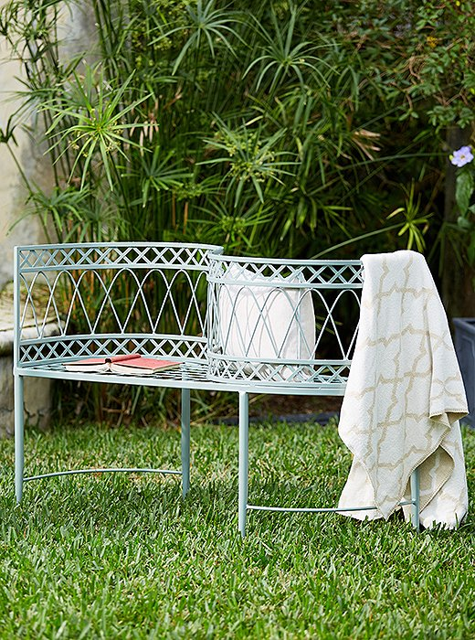 The Linden tête-à-tête, part of our exclusive outdoor collection, features delicate ironwork and makes for a unique addition to the backyard or the patio.