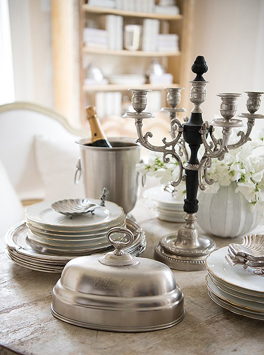 Antique French silver and porcelain add Continental allure to a table—and mix beautifully with newer pieces. Photo by Paul Costello.