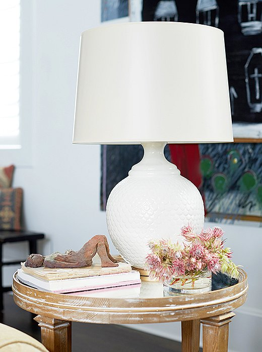"All the lighting in the lake house (included this table lamp) is, indeed, by Barbara. But the self-deprecating designer admits to feeling a little uneasy about that. ""When I started, I got so excited about having pieces from all of my colleagues in my home, and then my house started being photographed and my general manager said, 'You're going to have to put your own lights in your house now. You got to get rid of everybody else's. This is not working for PR!'"" Barbara admits with a laugh."
