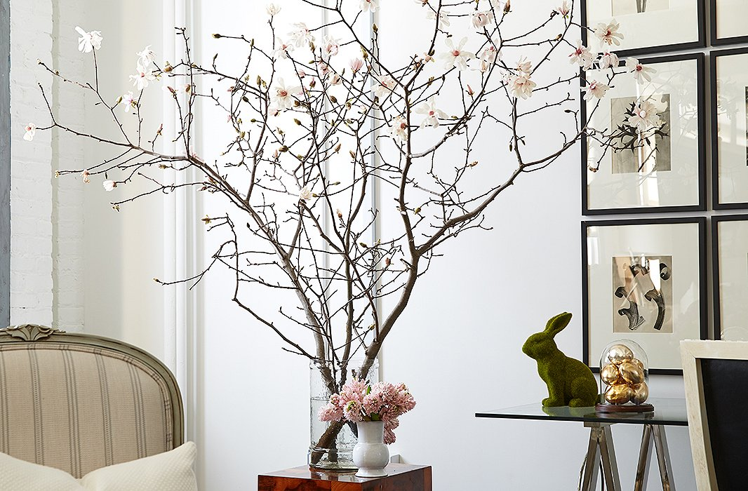 Set in a simple glass vase, these Japanese magnolia branches are the very essence of spring—especially when paired with pale-pink hyacinths and a charming rabbit figurine.