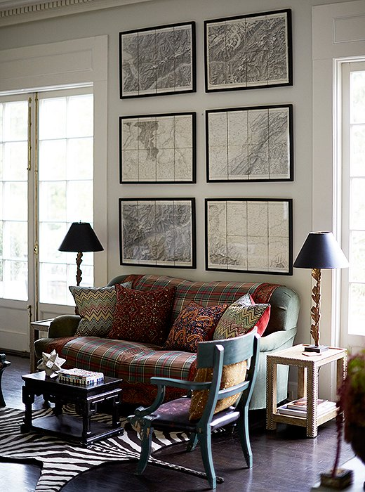 A series of framed maps brings classic polish to a cozy sitting area. Photo by Manuel Rodriguez.