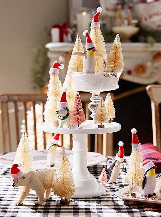 Bring a magical touch to your centerpiece with wintry critters, faux snow, and Santa hats.