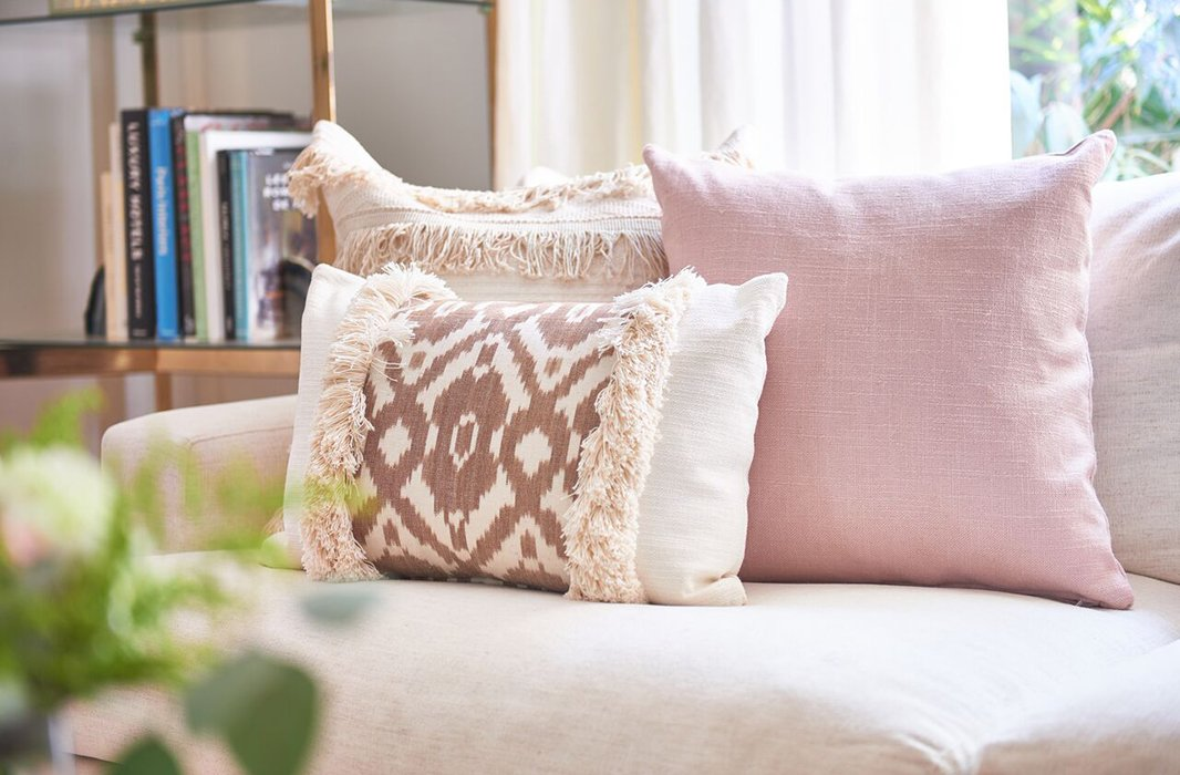 Kim Salmela pillows are made to be mixed and matched. Case in point: this harmonious medley of ikat, solid, and fringe.