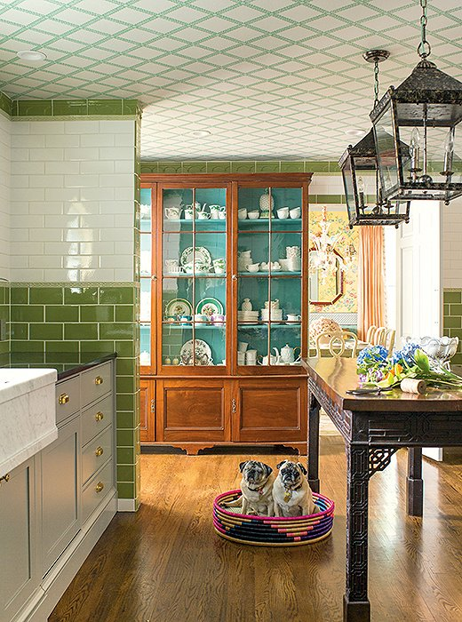 Chinoiserie details and wallpaper with a trellis motif add interest in John and Jason's own kitchen.