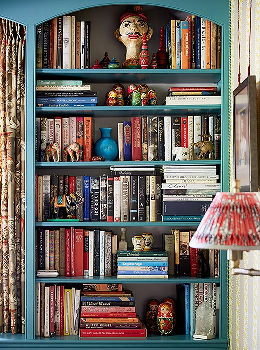 In John and Jason's library, bookshelves are lined with good reads and prized possessions from around the world.