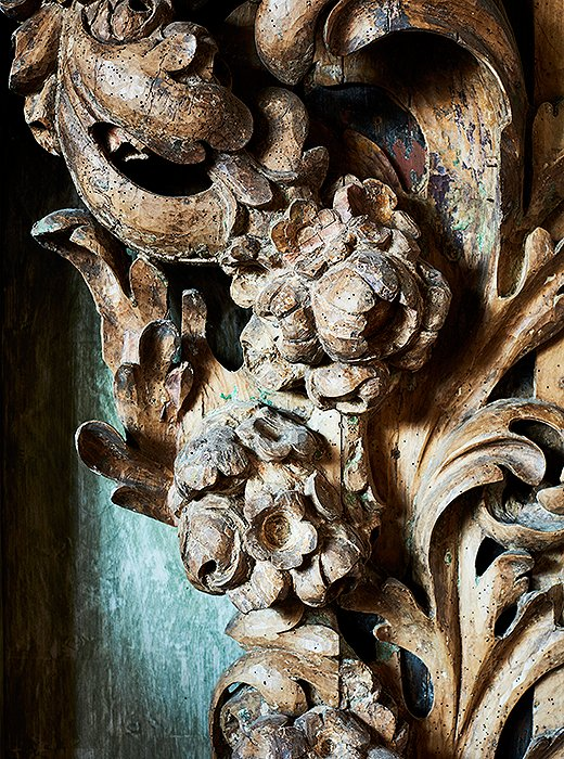 Though much of its original finish has faded, this carved-wood piece still shines with sculptural beauty.