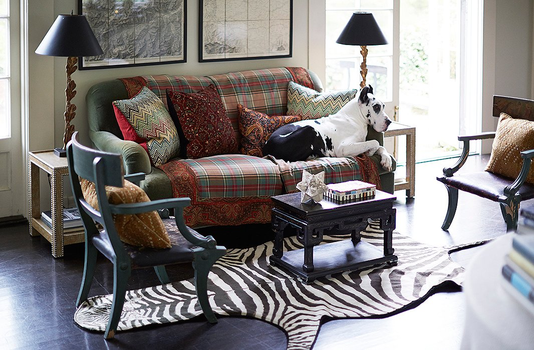 Pillows and throws in mismatched patterns make this sitting area even more welcoming. For a similar sofa, see the Brooke in forest green. And yes, in most English cottages the dogs are allowed on the furniture. Photo by Manuel Rodriguez. Room design by Dransfield & Ross.