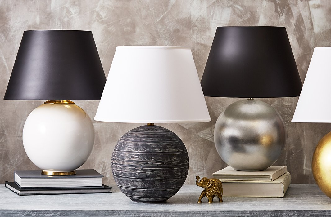 The spherical Pomona lamp complements both modern andtraditional decor beautifully—and comes in a bevy of styles, including scaled-down versions in sets of two.