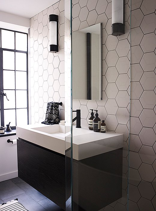 Hexagon tiles in the bathroom were difficult to install but give off a graphic effect that Suki and Morgan feel was well worth the challenge.