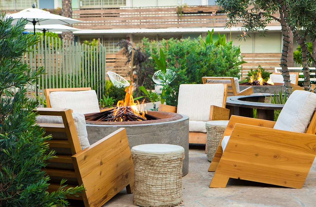 Guests can kick back by the fire pit with a cocktail—or a s'more. Photo courtesy of The Goodland.