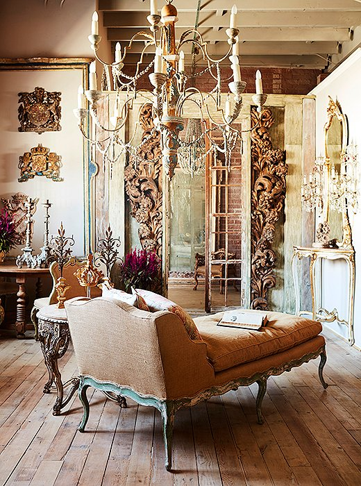 A graceful antique chaise anchors a vignette in Melissa's L.A. showroom, where carved, gilded, and crystal-encrusted surfaces delight the eye at every turn.