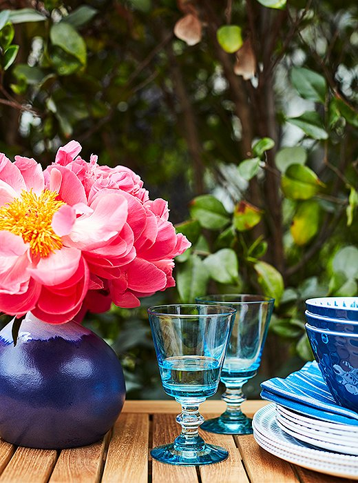 Blue ceramics and glassware brighten up the table, satisfying Kaling's desire for a layered, colorful look.