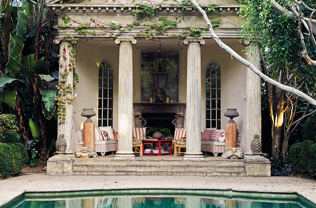 The poolside portico is a reproduction inspired by drawings for a structure by the 16th-century architect Andrea Palladio. Richard mixed authentic Roman column fragments with ones made of redwood and fiberglass, elaborately distressed.