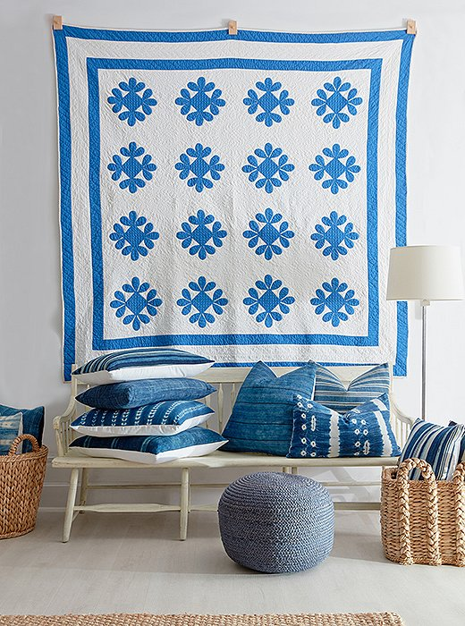 A charming quilt takes on new life as colorful wall decor.