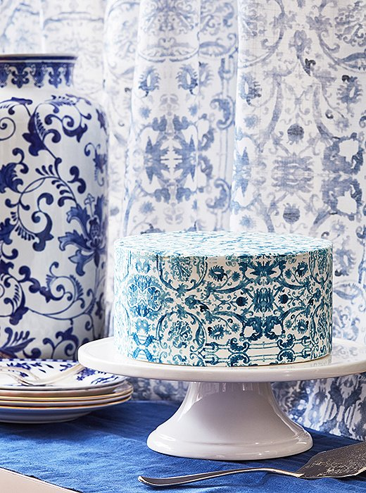 Shades by One Kings Lane for The Shade Store—featuring an exclusive abstract floral print—set off the apartment's dramatic two-story windows. Stephanie used the pattern as inspiration for one of her signature cake sheets.