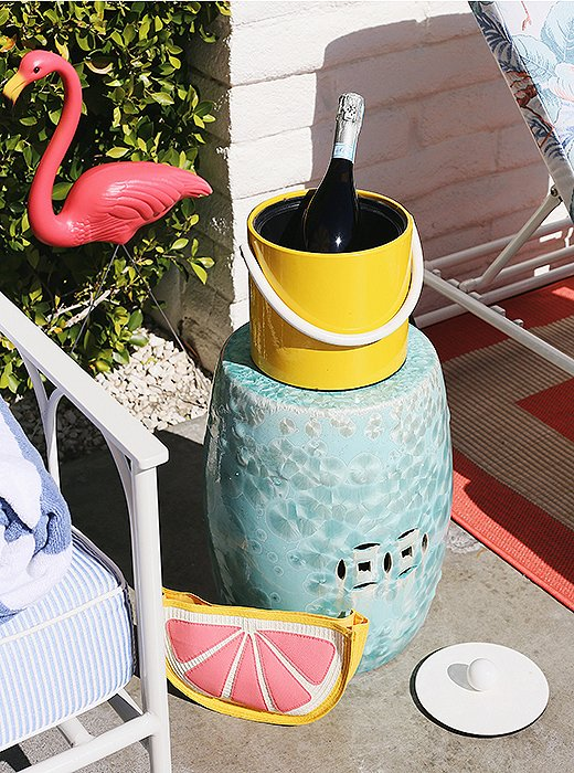 Topped with a vintage ice bucket, a garden stool makes an ideal outdoor (mini) bar.