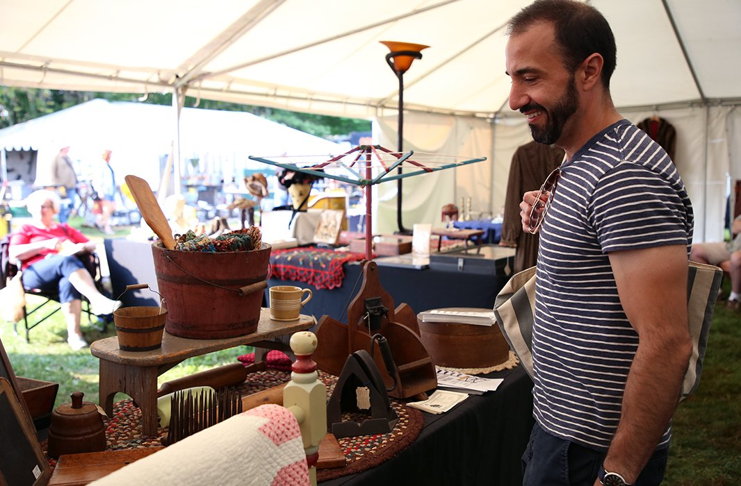 Anthony Santelli checks out a table filled with all-American antiques. Photo by Taylor Swaim.