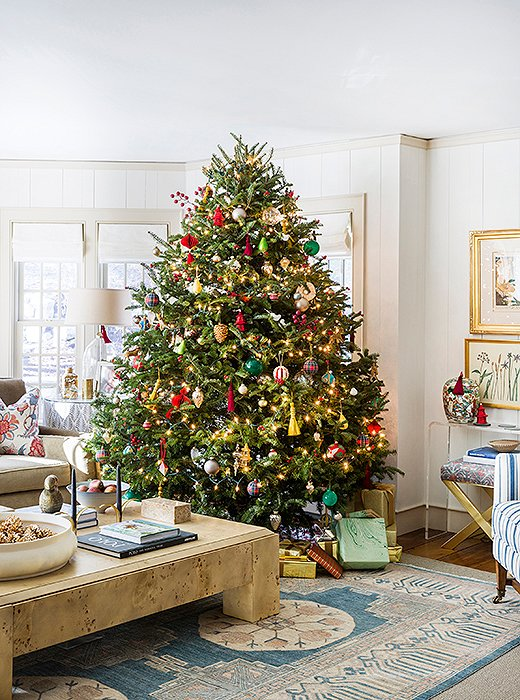The family room tree twinkles with white lights and ornaments of every shape and size.