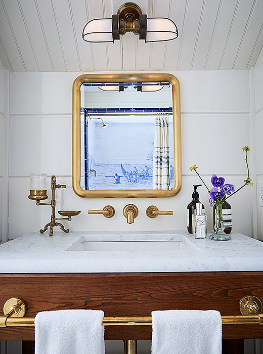 Stately—and stateroom-worthy—brass accents add an unfussy gleam to this shipshape bathroom. Photo by Tony Vu; styled by Eileen Benkhe.
