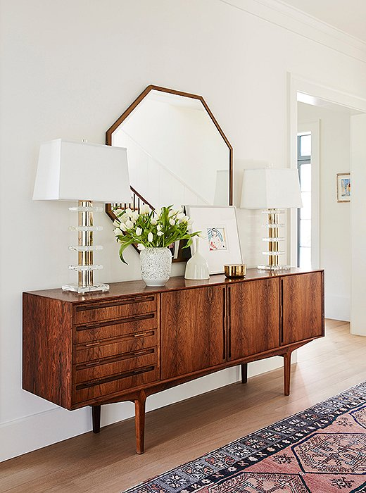 """Our favorite pieces in this house are the credenzas in the entryway and dining room,"" says Louisa. ""Those spaces were so specific; it was a little scary picking out vintage online. But they came in great condition and fit perfectly."" Jennifer wholeheartedly agrees: ""The best part of the entryway is that vintage credenza,"" she says. ""I'm so in love with it."""