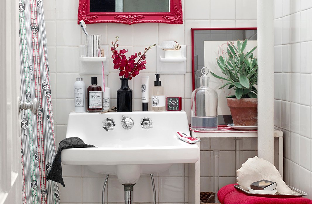 Vanity lessons: Simple touches like a fancier bottle of Botot mouthwash (the brand was a favorite of Louis XV) and a brush in a silver cup are easy ways to elevate the look of any bath.