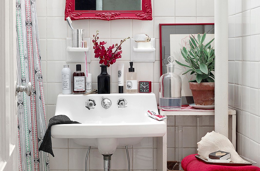 Vanity lessons:Simple toucheslike a fancier bottle of Botot mouthwash (the brand was a favorite of Louis XV) and a brush in a silver cup are easy ways to elevate the look of any bath.