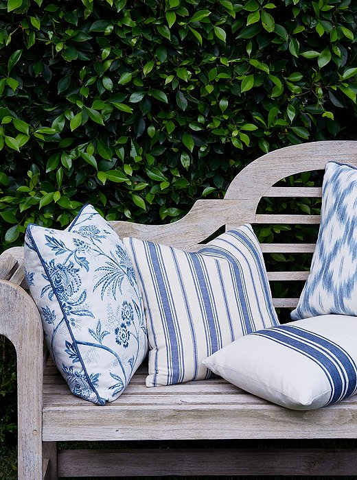 A blue-and-white palette unifies a collection of patterned pillows from Mark's line.