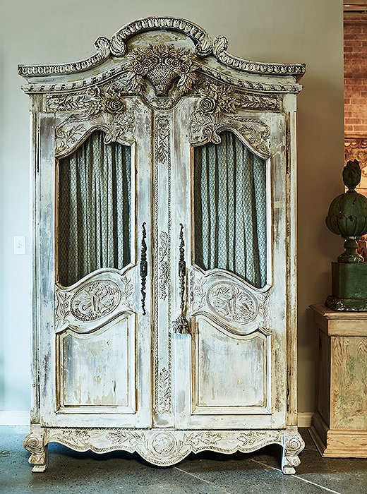 Each piece tells a story: This 19th-century carved French armoire was made as a wedding gift from a father to his newly married daughter.